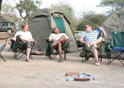 Sitting outside tents Volunteer Building with Kruger Safari in Swaziland