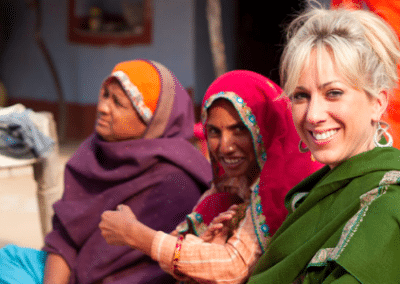 Volunteer with two women Women's Empowerment in India