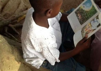 Child reading Mobile Literacy Development in Ghana