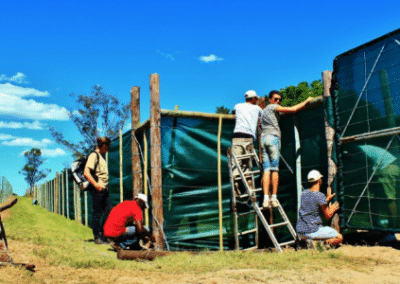 Volunteers maintaining fence big 5 South Africa