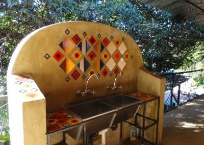 Shared sinks at backpackers Zambia