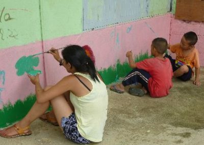 Participant painting a classroom wall